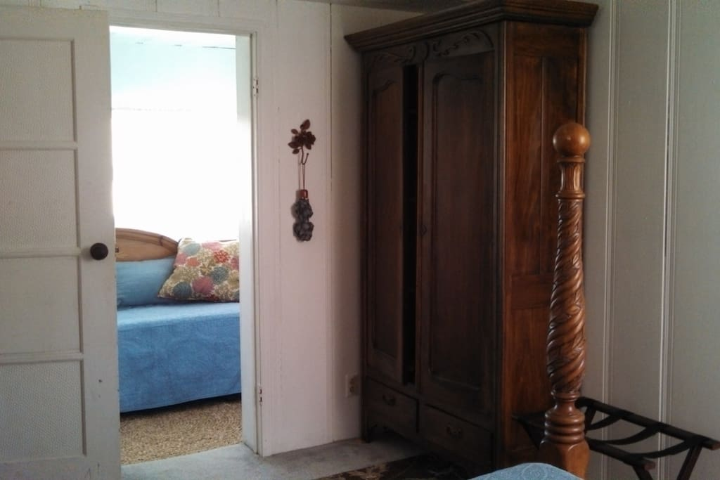 Antique French Country Armoire with additional sheets and blankets. Second room with twin size daybed and trundle (Serta mattresses).