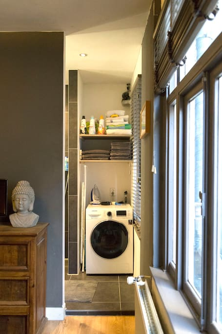 Entrance of bathroom and washer/dryer combination