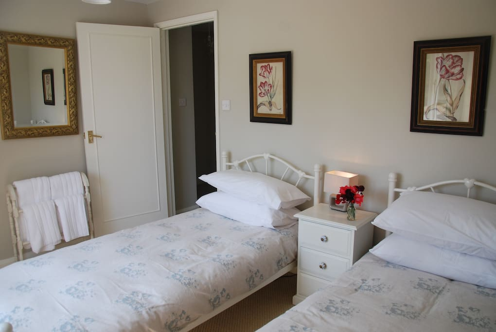 The twin bedroom overlooks the stable yard and has a large wardrobe.
