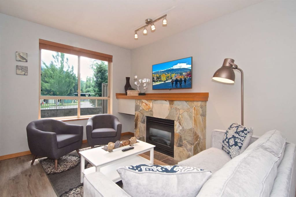 "Fully remodeled unit with new plank floors, all new furniture, 50"" wall mounted TV and View of Blackcomb mountain"