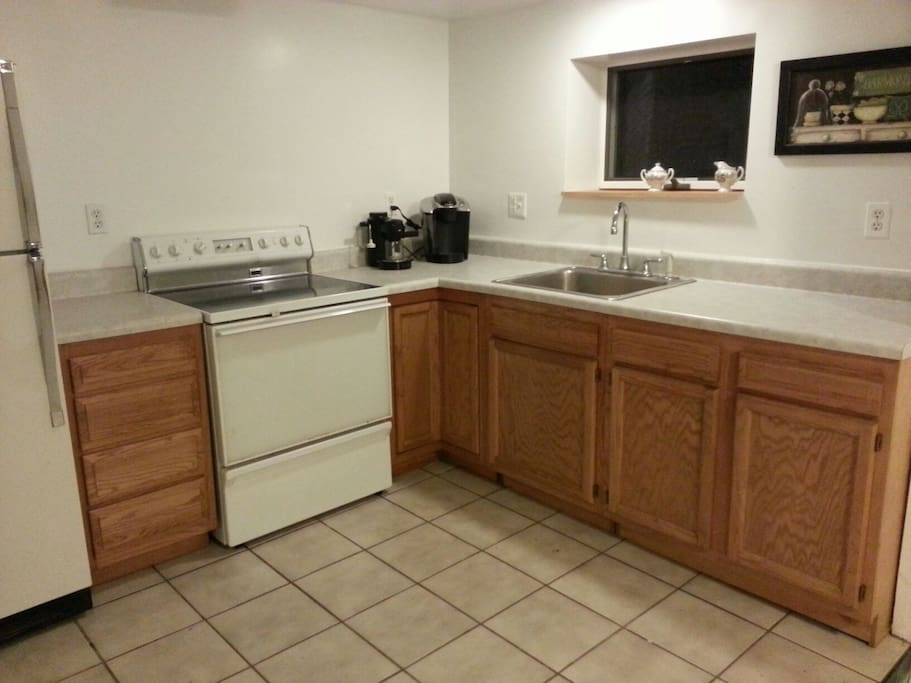 Fully equipped kitchen with Keurig and expresso.