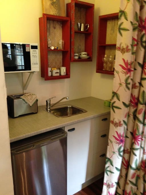 Kitchenette contains Capsule Coffee Maker, Microwave, Kettle, Toaster, Refrigerator, sink.