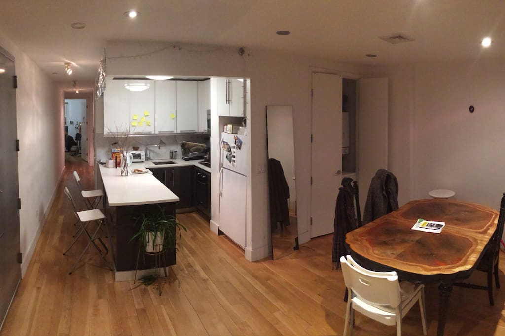 The dinning room and kitchen with dishwasher and microwave.