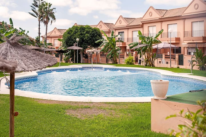 Air-Conditioned Apartment Close to Beach with Pool, Terrace, Garden & Wi-Fi; Parking Available