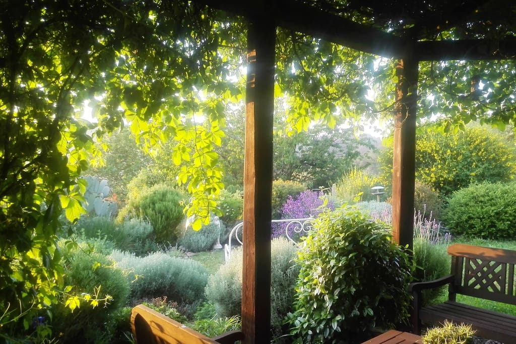 A shady pergola with fantastic views of the valley for meals and relaxation.