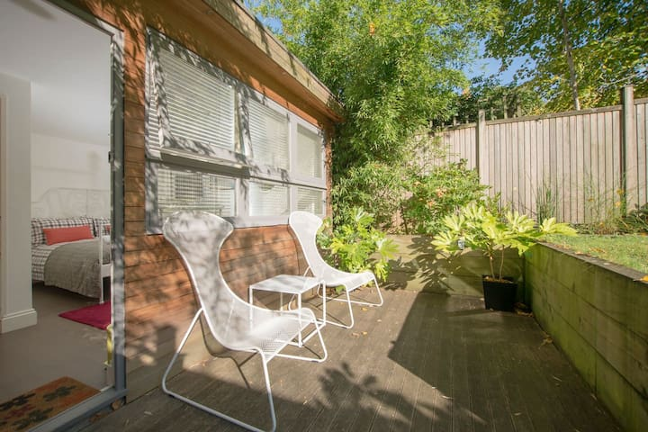 Sunny Studio with Lovely Patio 1