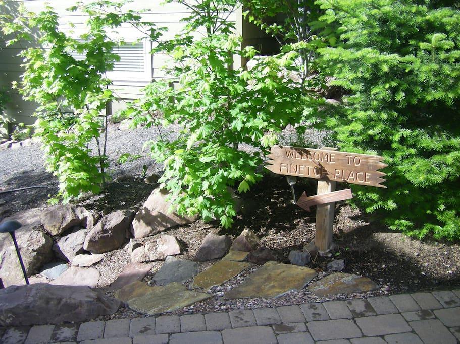 Garden-like stone path alongside the house.