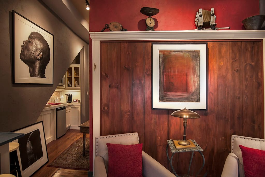 Red wood wall next to hall leading to Kitchenette and bathroom