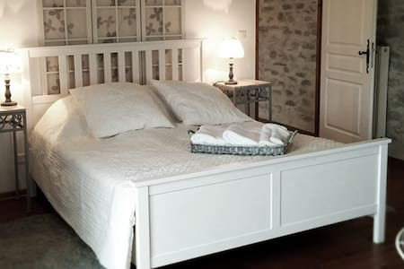 Luxury king-size hotel beds with deep mattresses, cotton sheets and fine pillows.