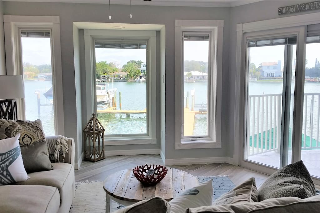 Beautiful water views from the living room, kitchen, dining area, master bedroom, balcony, and partial gulf/beach view from second bedroom