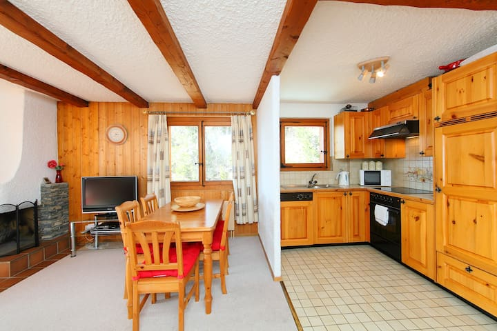Spacious dining area and well-equipped kitchen