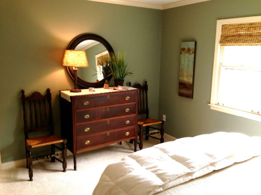 Dresser/chairs in bedroom.