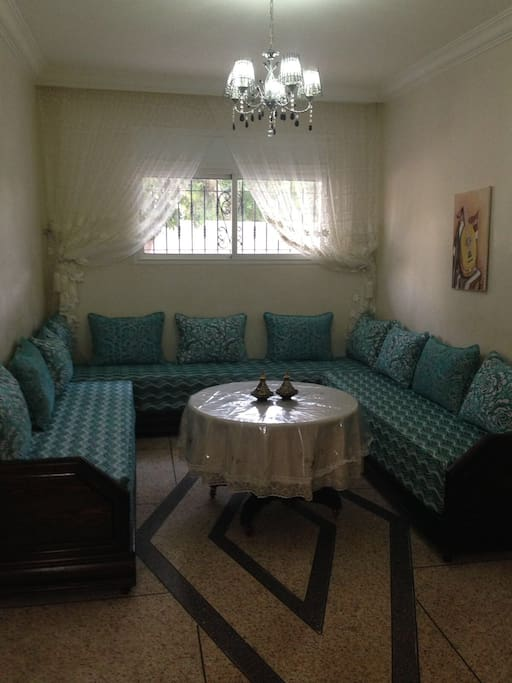 Relax on the traditional morrocan sofas while watching a movie :)