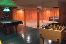 Game room basement. pool table, Foosball, ping pong table is also set up now.  Lots of toys for kids in the corner.