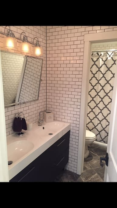 Newly remodeled bathroom with floor to ceiling tile