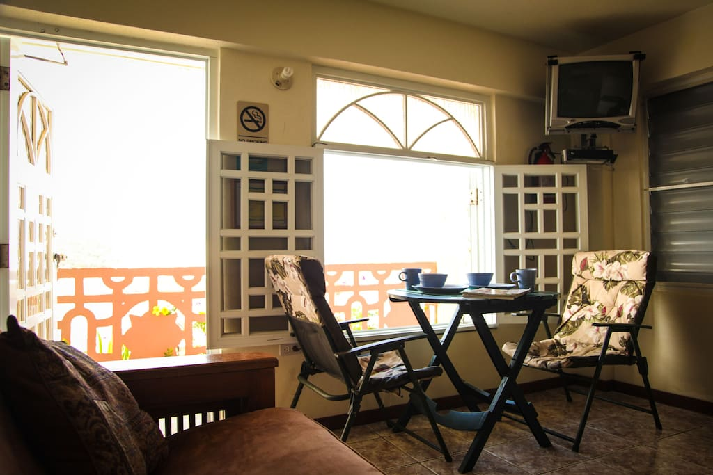 Room has a nice breakfast area with a  wonderful view of Ensenada Honda Bay.