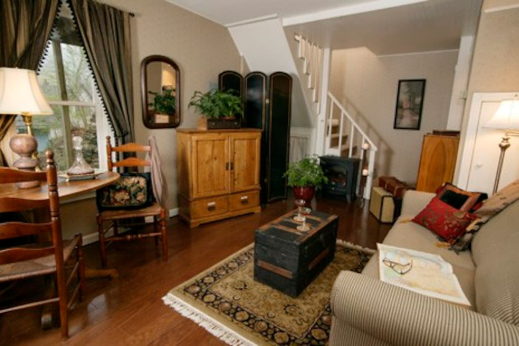 Comfortable downstairs sitting area, cable TV, minibar area.