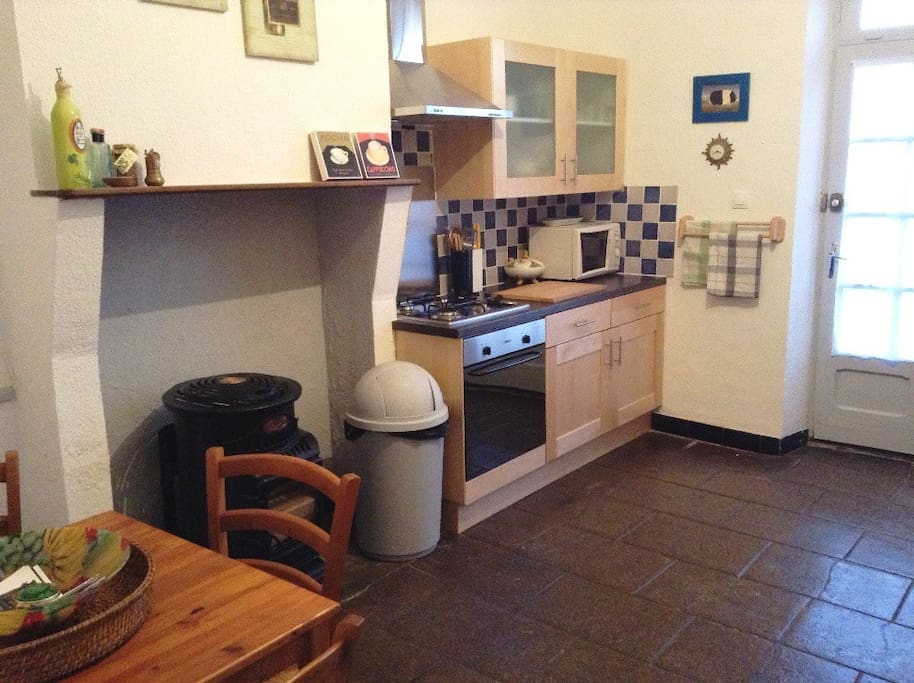 New kitchen with electric oven, gas hob, mobile gas heater