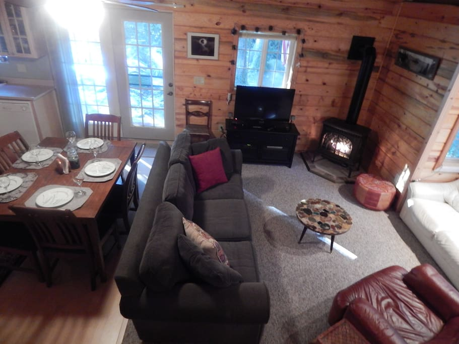 Living area with remote gas stove, Apple TV, and cozy conversation area.