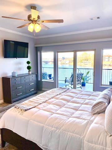 Enjoy lakefront views from the comfort of your king bed