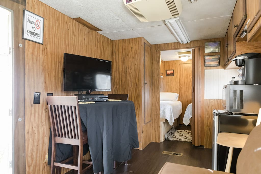 Private bedroom with 2 twin beds and a sliding door for privacy.