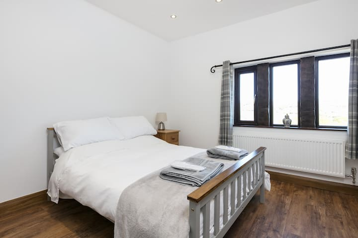 Bedroom 1 - double bed with walk-in wardrobe and ample drawer storage.