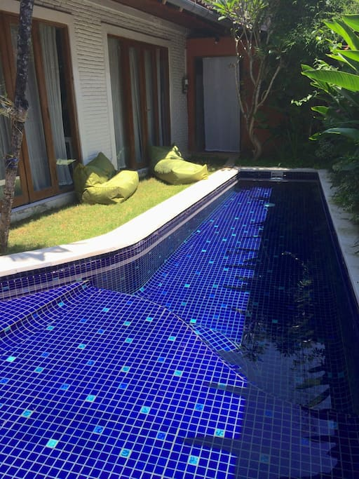 The swimming pool is 9 meters long (enough for swimming) and there are comfy bean bags for lounging.
