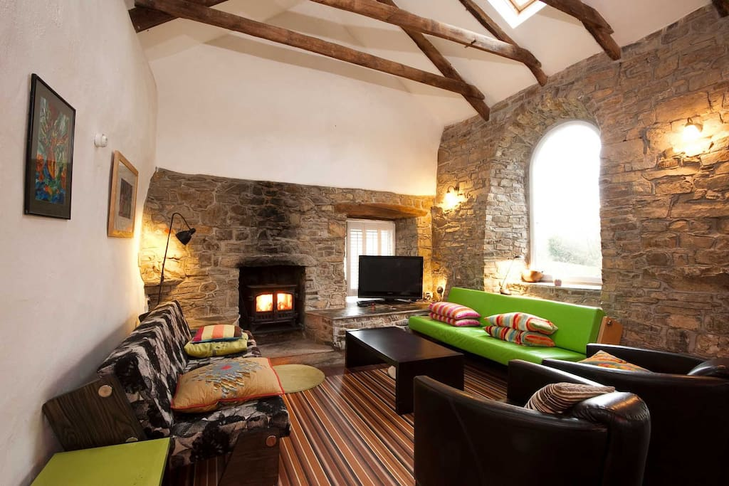Spacious sitting room with wood burner