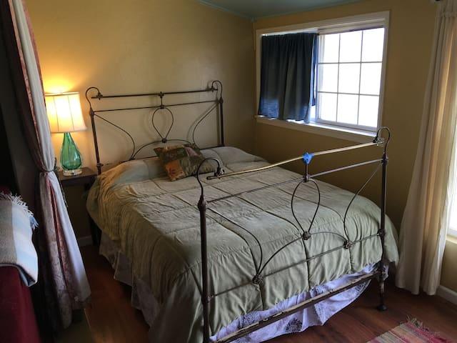 Queen bed off front room