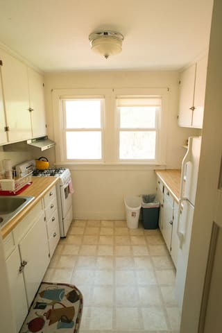 The kitchen is just off the living room and has a gas stove, a full set of dishes and utensils, and good cookware. There is a coffee maker (and coffee!), teapot, and microwave. I can furnish a rice maker, coffee grinder, and bread maker on request.