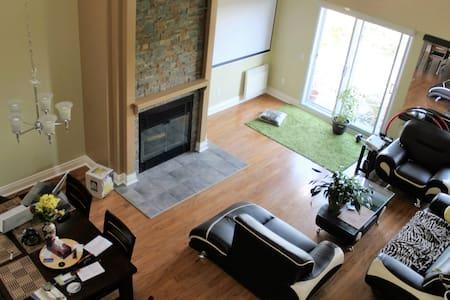 Sunny & Spacious Condo with 2 bedrooms + Mezzanine - Condominium