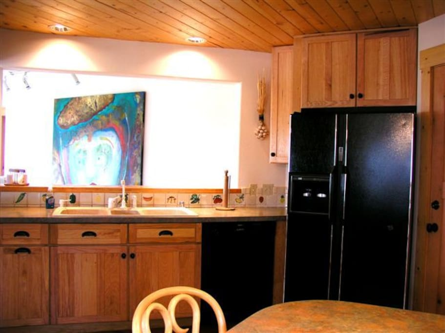 Kitchen fully eqqupped with dishwasher, jumbo fridge, built in wall oven (not shown)