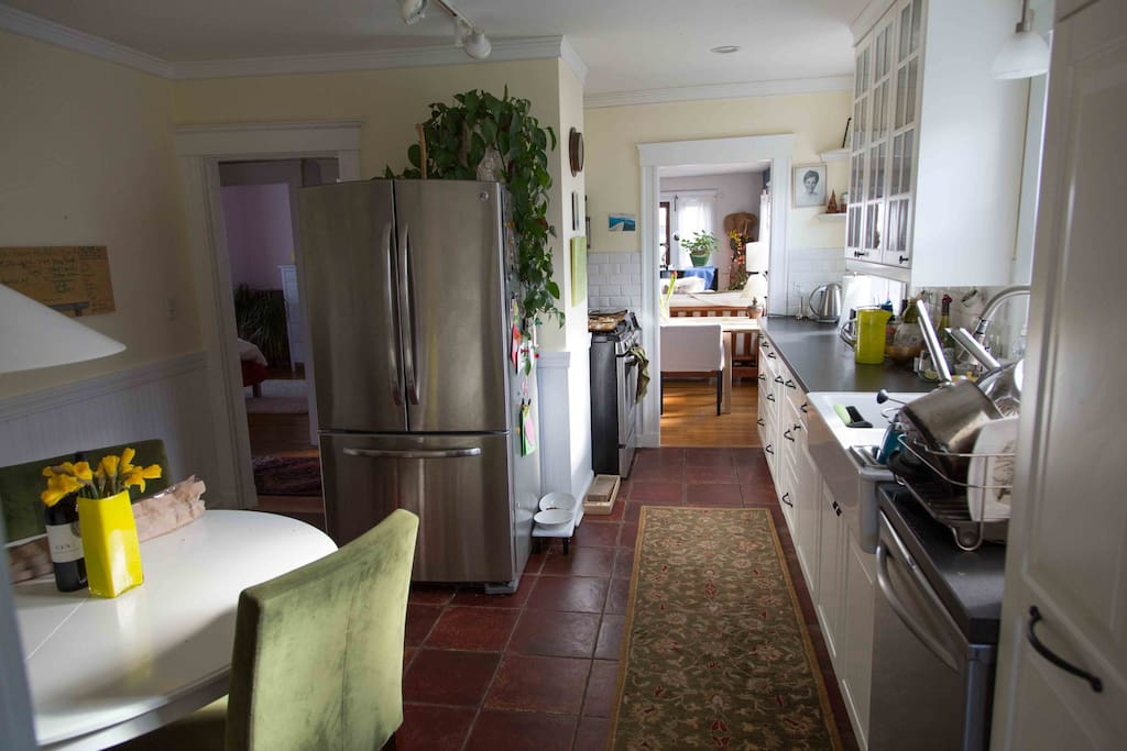 Sunny fully-furnished kitchen with an expandable table.