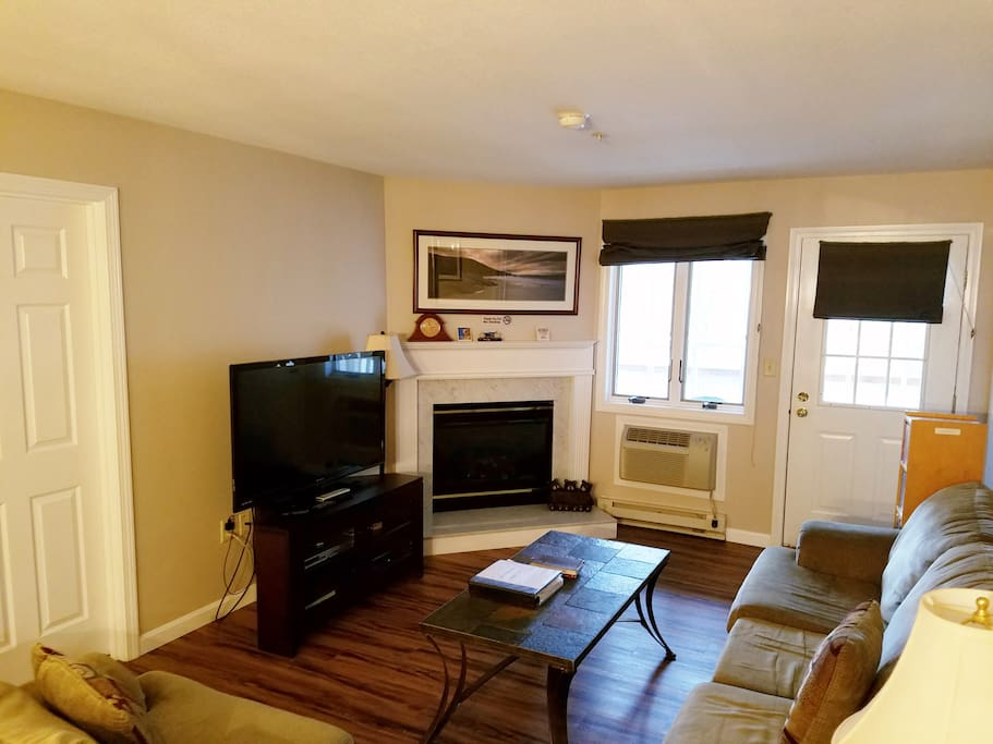 "Living Room with Gas Fireplace, air conditioning and 50"" LED TV"
