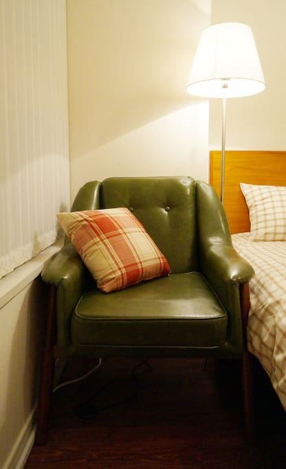 A Vintage Green Leather Chair with a Foot Stool