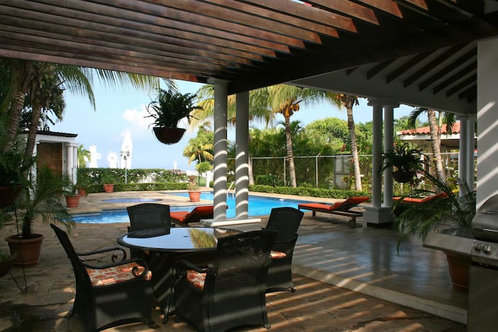 Outdoor Patio with seating area, beach front view, swimming pool and BBQ