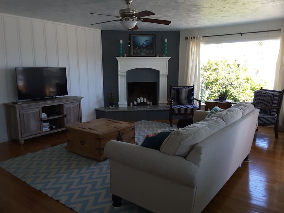 Large flat screen TV, fire place, large picture window