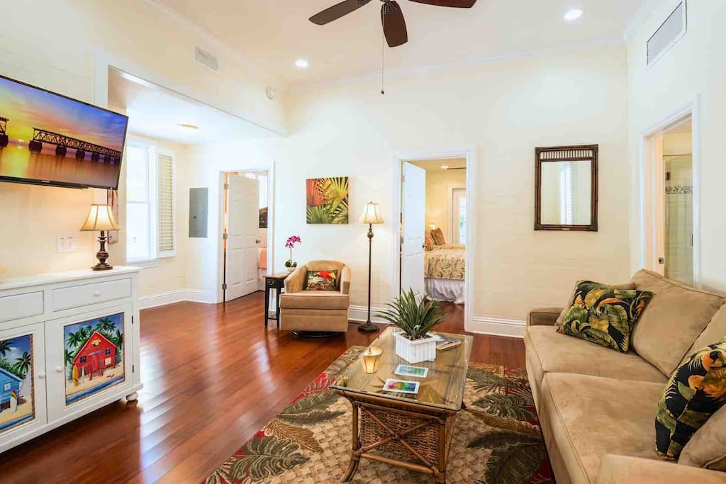 The living room has tall ceilings and plenty of comfortable seating...