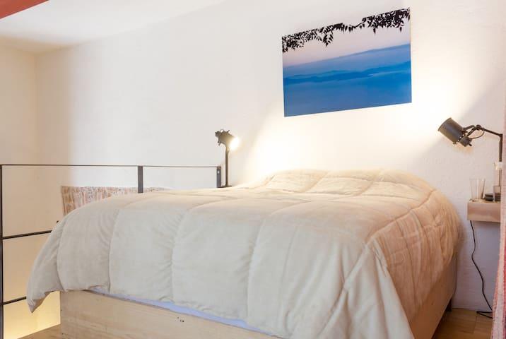 Queen Size bed on top floor.