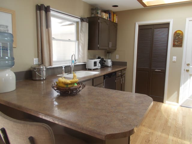 large kitchen with lots of counter space and skylight.