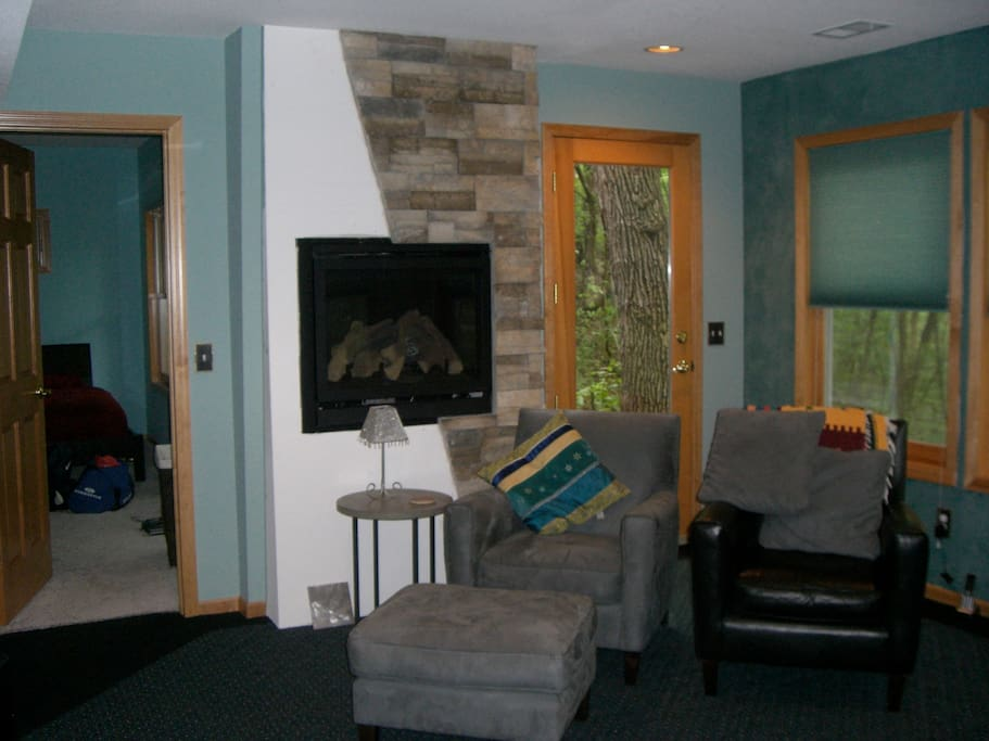 Family room with fireplace and cable television