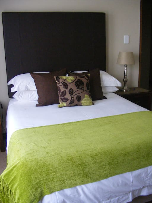 Room 1 - Double Bed. Bathroom with shower.