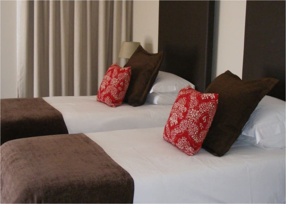 Room 3 - Two single beds or one King size bed. Balcony overlooking backyard, town & mountains. Bathroom with shower and beautiful large bath.