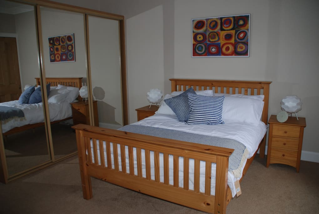Large bright, spacious double bedroom with fitted wardrobe and chest of drawers