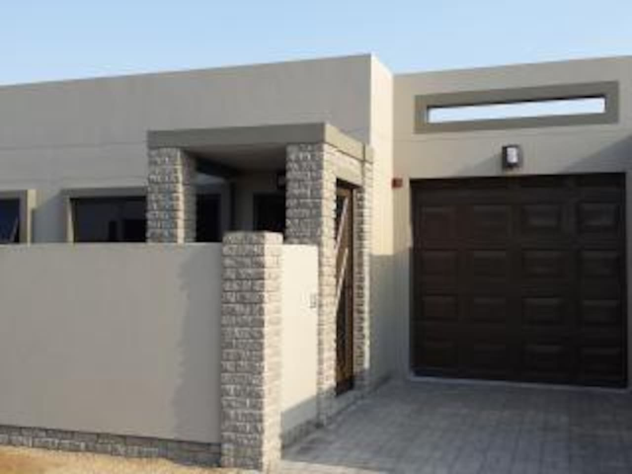 Main, private entrance with lockup garage