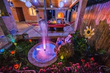 MAGICAL COLORFUL FOUNTAIN AND DINNING AREA WITH BBQ