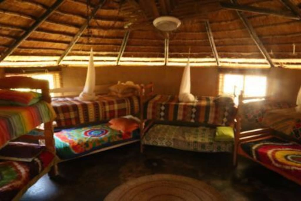 Wakka Wakka Dormitory – Typical Zulu mud hut/rondavel. Sleeps 12 in 6 bunk beds. Ablutions shared. Own braai area, mini bar fridge. Or communal kitchen/braai area