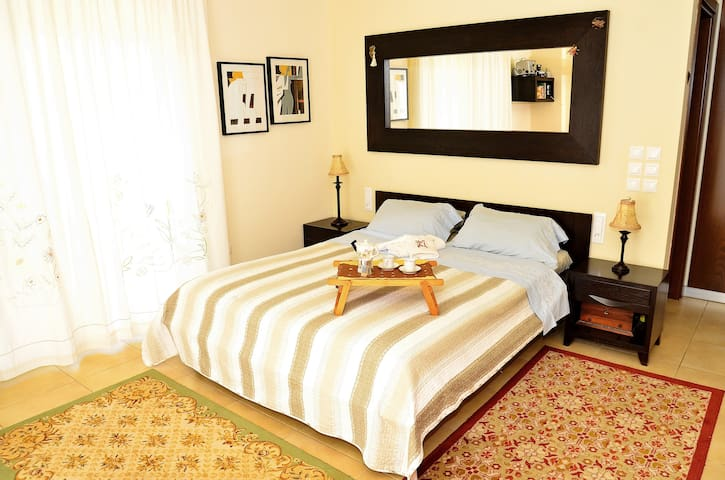 Master bedroom with an en suite bathroom (20 sqm including bathroom), with orthopaedic mattress and a laptop working space