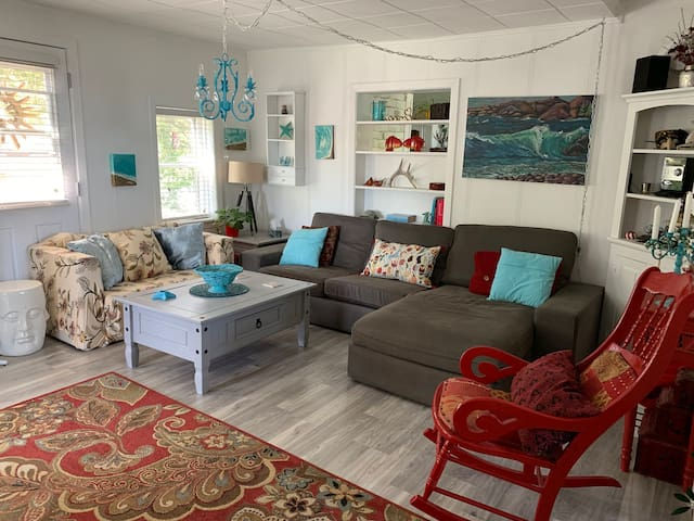 Stylish living room with comfortable seating. Perfect for playing games or watching tv.
