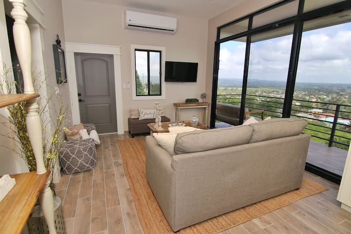 Air conditioned living room offering stupendous views of San Ignacio Town and mountains in a distance.